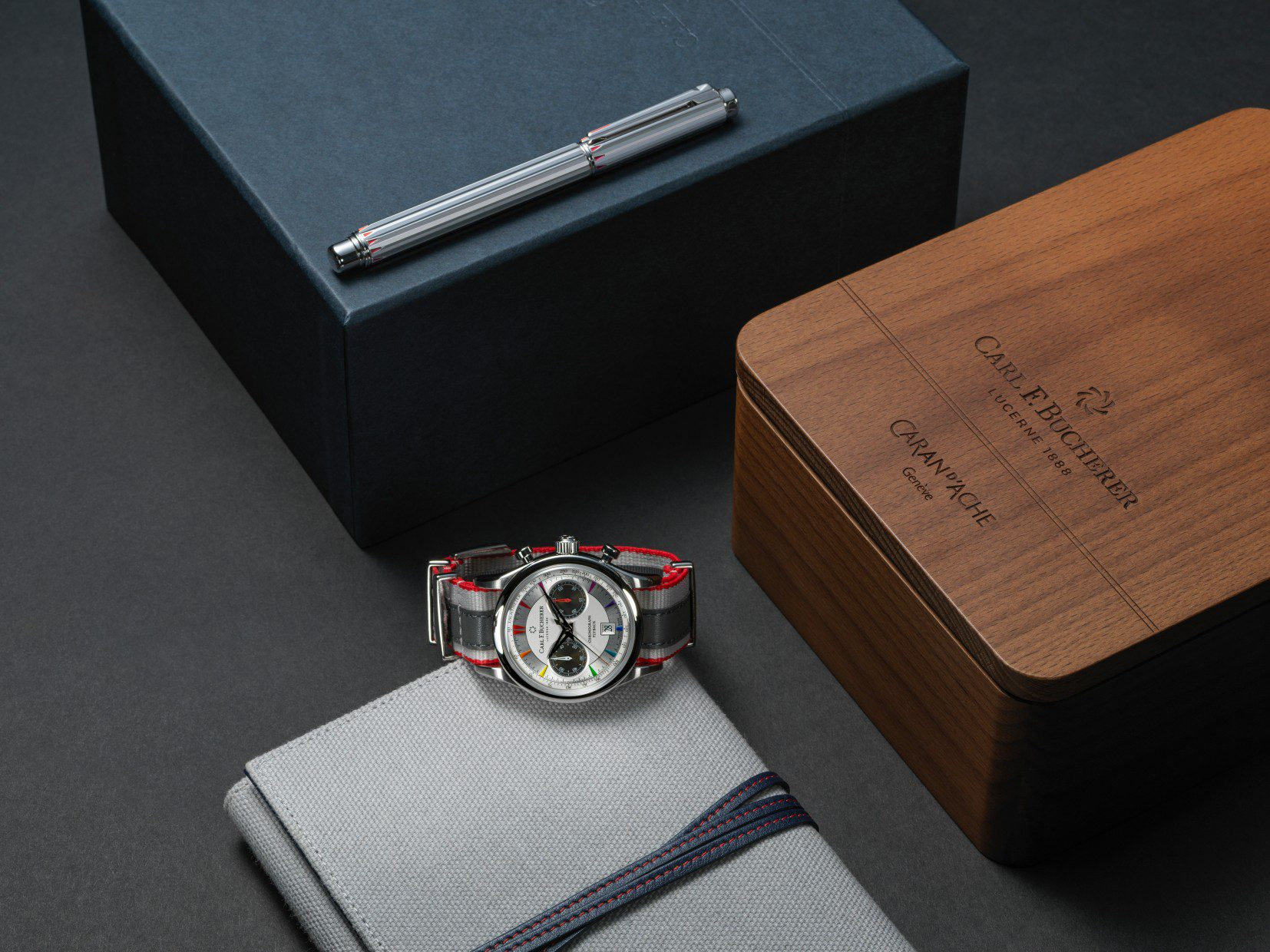 Carl F. Bucherer Manero Flyback Signature watch and the Caran d'Ache Signature rollerball pen.